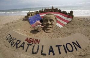 World election reaction: Puri, India: Sand sculpture Barack Obama on beach