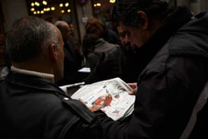 World election reaction: Madrid, Spain: People read a news paper with the US elections results