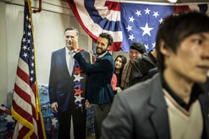 World election reaction: Kabul, Afghanistan: An Afghan journalist gestures with photo of Mitt Romney