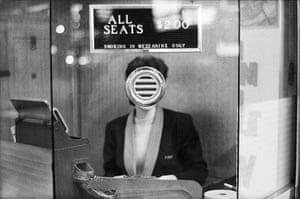 Joel Meyerowitz Monograph: A woman's face is obscured by speaker in ticket booth