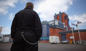 A prison officer stands outside HMP Birmingham, one of five prisons run by private firm G4S.