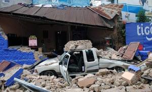 Guatemala Earthquake: A car remains under the ruins of a colla