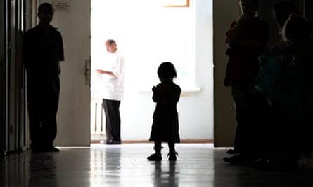 Anonymous small girl in hospital corridor