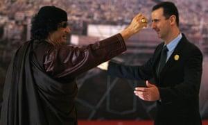 Syrian President Bashar al-Assad and Libya's leader Muammar Gaddafi at a Arab Summit in Damascus in March 2008.