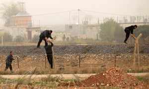 Syrians cross the border into Turkey near the Turkish town of Ceylanpinar. Five Turks in Ceylanpinar, which lies across from Ras al-Ain, were lightly wounded on Wednesday  by ricocheting bullets from the Syrian side.