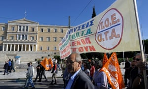 Municipal workers march during a protest against austerity measures in front of the Greek Parliament building in Athens, Greece, 09 November 2012.