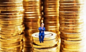 Stack of coins with model man sat on top