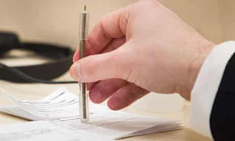 Anders Behring Breivik holding his 'stab-resistant' pen