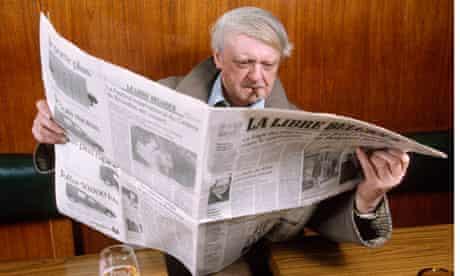 Anthony Burgess reading Belgian newspaper La Libre Belgique while smoking
