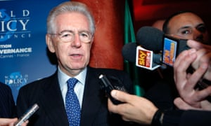 Italy's prime minister Mario Monti answers to media, as he arrives at the World Policy conference in Cannes, southern France, Saturday, Dec. 8, 2012.