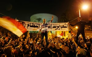 Egypt protests: Protesters chant slogans in front of the presidential palace in Cairo