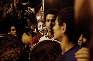 Egypt protests: An Egyptian man wearing an 'Anonymous' mask takes part in a demonstration