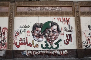 Egypt protests: Graffiti likening president Morsi to Council of the Armed Forces leader