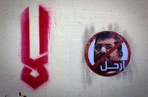 Egypt protests: A sticker depicting president Morsi, with Arabic that reads 'leave'