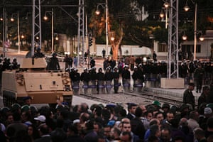 Egypt protests: Egyptian riot police stand guard as protesters chant