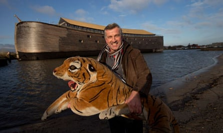 Johan Huibers poses with a stuffed tiger in front of his Noah's ark