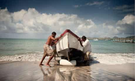Fishermen bringing a boat in