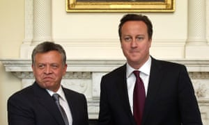 King Abdullah II of Jordan shakes hands with David Cameron inside 10 Downing Street.