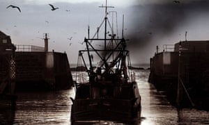 Fishing boat heading out of Eyemouth harbour, Scotland