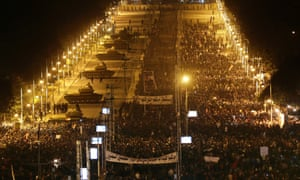 Egyptian Army tanks deploy as Egyptian protesters gather outside the presidential palace during a demonstration against President Mohamed Morsi in Cairo on Tuesday.  Thousands of opponents and supporters of Egypt's Islamist president staged rival rallies.