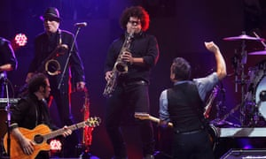 Singer Bruce Springsteen (R) performs with Nils Lofgren (L) and Jake Clemons (centre), nephew of the late Clarence Clemons, during the 12.12.12 benefit concert for victims of Superstorm Sandy at Madison Square Garden in New York.