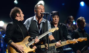Nils Lofgren, Bruce Springsteen and Steven Van Zandt of The E Street Band perform at 12.12.12. concert benefiting The Robin Hood Relief Fund to aid the victims of hurricane Sandy.