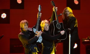 Jon Bon Jovi, centre, performs during the 12.12.12  Concert for Sandy Relief at Madison Square Garden in New York.