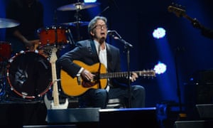 Eric Clapton performs during  the 12.12.12. Sandy relief concert at Madison Square Garden in New York.
