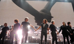 Roger Waters and Eddie Vedder perform at a concert benefiting The Robin Hood Relief Fund to aid the victims of Hurricane Sandy.