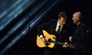 Chris Martin and Michael Stipe on stage at Madison Square Garden for the Sandy relief concert.