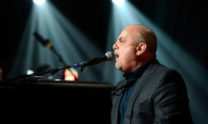 Billy Joel performs at 12.12.12, a concert benefiting the Robin Hood Relief Fund to aid the victims of Hurricane Sandy.