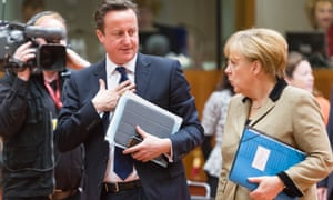British prime minister David Cameron talking to Germany Chancellor Angela Merkel ahead of an EU meeting.