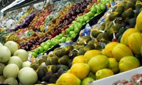 Fruit and vegetables on the shelves at a supermarket