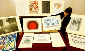 A Royal Academy employee displays works included in the diamond jubilee gift to the Queen