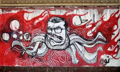 President Mohamed Morsi depicted as an octopus in graffiti on a wall of the presidential palace