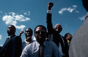 Nelson Mandela: 1994: Bodyguards keep close watch of Nelson Mandela