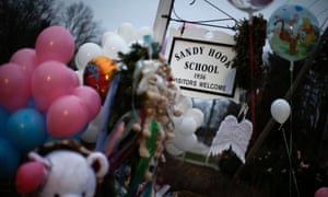 A makeshift memorial near the entrance to the Sandy Hook Elementary School for the victims of a school shooting in Newtown, Connecticut.