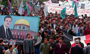 Palestinians in Yarmouk camp, Damascus, demonstrate in 1998 in support of then president Hafez Assad