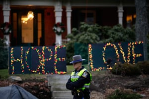 Sandy Hook: A Connecticut State Police Officer stands at an intersection in Newtown