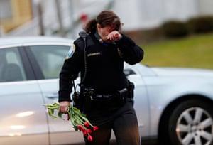 Sandy Hook: Newtown Police Officer Maryhelen McCarthy brings flowers