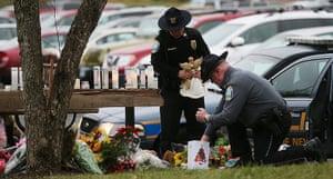 Sandy Hook: Newtown Police officers leave mementos at a makeshift memorial