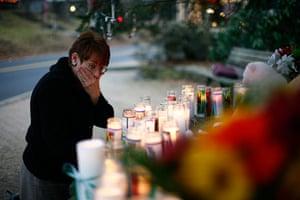 Sandy Hook: A woman reacts at a memorial near Sandy Hook Elementary School