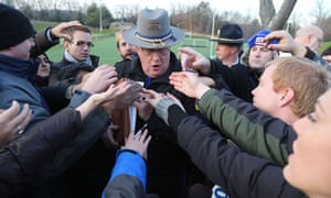 Lieutenant Paul Vance of the Connecticut State Police is surrounded by reporters