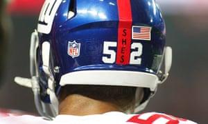 New York Giants Spencer Paysinger (52) sports a decal on his helmet honoring those killed in the Sandy Hook Elementary School shootings