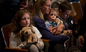 Residents wait for the start of a vigil for the victims of the Sandy Hook Elementary School shooting.