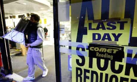 A shopper leaves a Comet store with discounted items