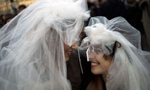 Two women wearing wedding veils
