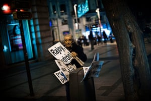 24 hours in pictures:  A man places banners in a  bin after leaving a Union demonstration
