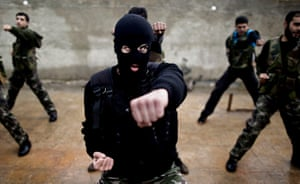 24 hours in pictures: Syrian rebels attend a training session in Maaret Ikhwan