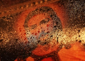 24 hours in pictures: Raindrops rest on a Jesus painting at a memorial in Newtown